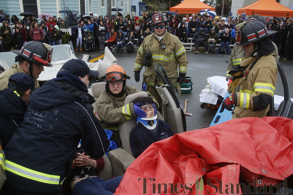 . Shaun Walker � The Times-Standard  Emergency personnel help pretend DUI accident victim Ruby Vadas to an ambulance during a simulated student drunk driving accident scene in front of Arcata High School on Thursday morning. Every 15 Minutes is a two-day program which demonstrates to high school students the impact drinking and driving has on friends, families, and their community. The event included emergency responses from police, fire, ambulance, coroner, public works, and tow truck companies. The program will conclude with a mock funeral assembly for students.