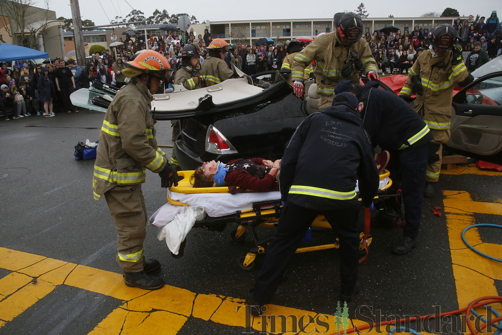. Shaun Walker � The Times-Standard  Emergency personnel take pretend DUI accident victim Nigella Bauerlighter to an ambulance during a simulated student drunk driving accident scene is in front of Arcata High School on Thursday morning as a student film crew documents it for an assembly. Every 15 Minutes is a two-day program which demonstrates to high school students the impact drinking and driving has on friends, families, and their community. The event included emergency responses from police, fire, ambulance, coroner, public works, and tow truck companies. The program will conclude with a mock funeral assembly students.