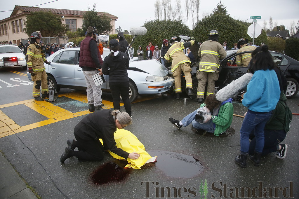 . Shaun Walker � The Times-Standard  Reverand Sarah Potter covers the body of pretend fatal DUI accident victim Zalen Garen during a simulated student drunk driving accident scene in front of Arcata High School on Thursday morning as a student film crew documents it for an assembly. Every 15 Minutes is a two-day program which demonstrates to high school students the impact drinking and driving has on friends, families, and their community. The event included emergency responses from police, fire, ambulance, coroner, public works, and tow truck companies. The program will conclude with a mock funeral assembly for students.