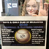 """KEVIN HARVISON  <br /> McAlester Boys and Girls Club Program Director Darby Brookshire tapes up a 2020 Baseball and Softball League flyer. Draft League sign ups are now through March 6, ages 3-12 with an active membership ($25) and activity fee ($40). Intact League sign ups are now through March 20 ages 8-12 with a $350 per team due by March 20th. A late sign up for intact teams after March 20 is $400. Individual draft sign up forms and intact team roster forms can be down loaded at  <a href=""""http://www.bgcmok.com"""">http://www.bgcmok.com</a>. For more information contact 918-426-5145."""