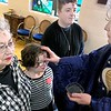 KEVIN HARVISON  <br /> Mother Janie Koch, right, applies ashes to members of the All Saints Episcopal Church Wednesday. Ash Wednesday is a Christian holy day of prayer and fasting.