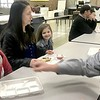 KEVIN HARVISON |<br /> Cole Evans, left, pulls back his cinnemon roll as his father Jason Evans just missed as he playfully reached for a bite of the breakfast roll during a Parker Intermediate Center 5th Grade Sweets with your Sweetheart Breakfast Wednesday morning.