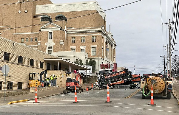 KEVIN HARVISON |<br /> Utility work on north Second Street continues as a crew works to install new pipe Tuesday.