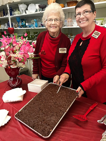 KEVIN HARVISON |<br /> Pictured from left, Twila Gray and Brenda Baxter pose for a pictured before cutting into some chocolate Friday at North Town's JJ McAlester Antiques in preparation for visitors of the Chocolate Tour event.