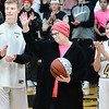 "KEVIN HARVISON |<br /> Cancer survivor Kathy Hunt, center, was honored between the ""Pink Out"" games versus Durant Tuesday at Bob Brumley Gymnasium."