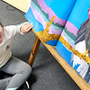 KEVIN HARVISON | Staff photo<br /> Tenley Ohls reads a big book on buzzards while in her Emerson Elementary classroom.