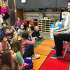 KEVIN HARVISON |<br /> Brian Flynn, McAlester resident and Major League pitcher for the Texas Rangers, visits William Gay Kindergarten Center to read to students. Flynn read Pete the Cat and shared the importance of reading and education to the students.