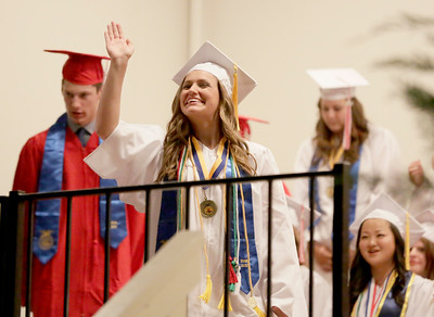 Shaun Walker — The Times-Standard  Class President Genevieve Regli waves at Ferndale High School's graduation ceremony at the Humboldt County Fairgrounds on Friday night. The school graduated 37 students.