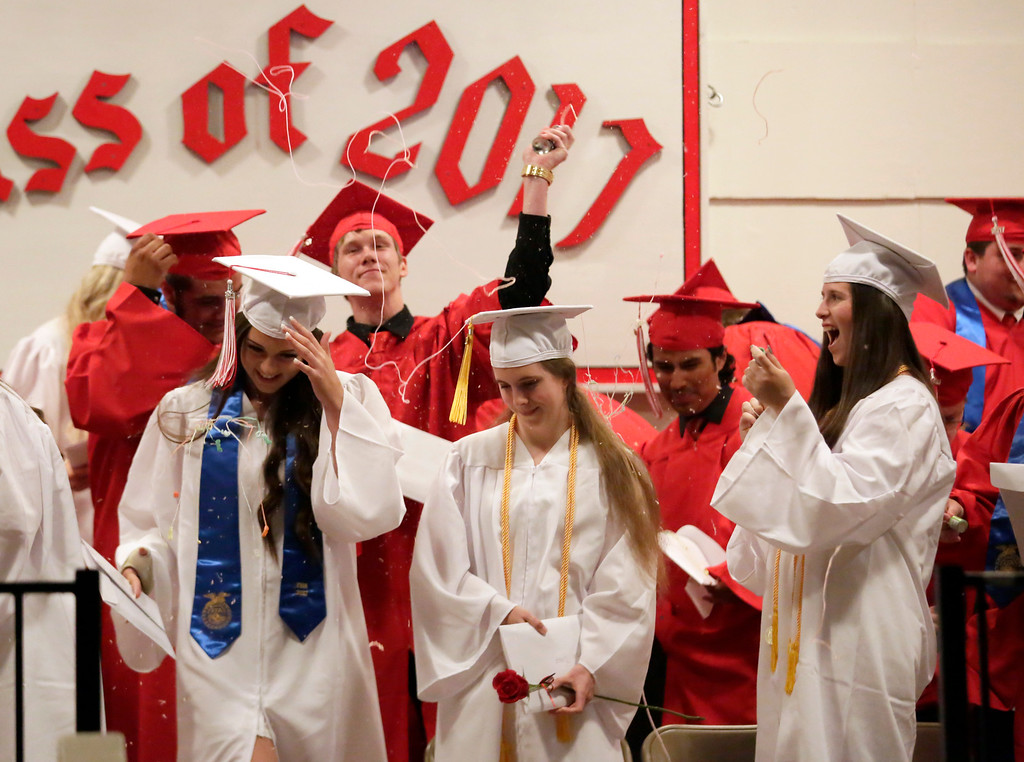 . Shaun Walker � The Times-Standard  Graduates celebrate at the end of Ferndale High School\'s graduation ceremony at the Humboldt County Fairgrounds on Friday night. The school graduated 37 students.