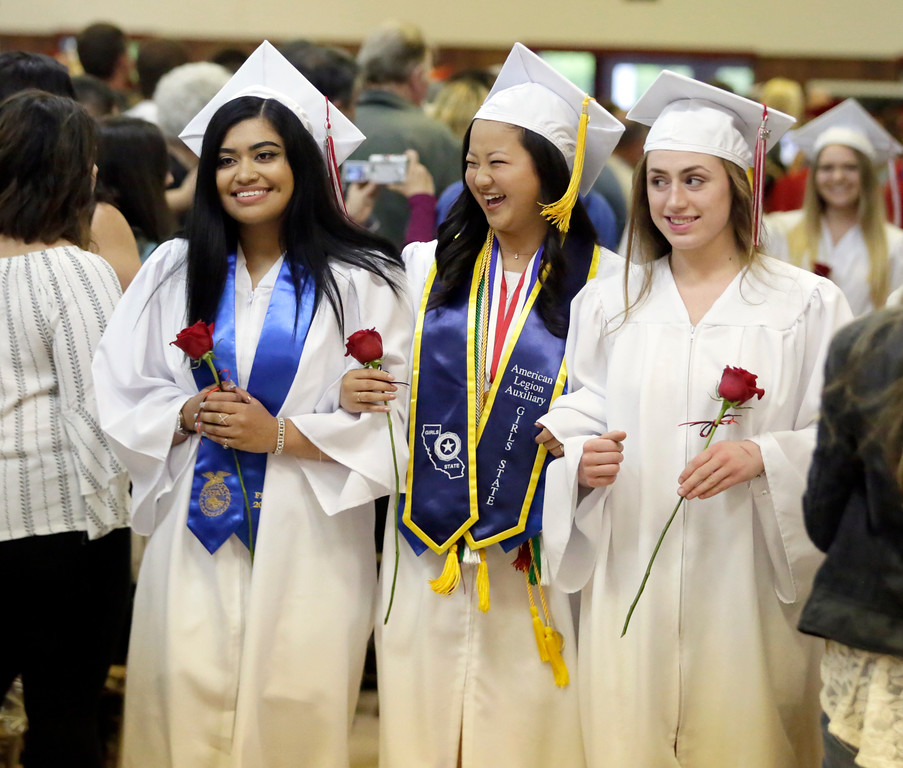 . Shaun Walker � The Times-Standard  Ferndale High School seniors smile as they approach the stage at their graduation ceremony at the Humboldt County Fairgrounds on Friday night. The school graduated 37 students.