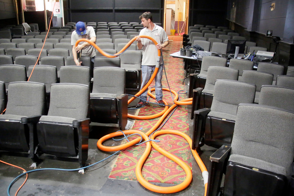 . Shaun Walker � The Times-Standard  Isaiah Hardwick, left, and Chris Littlejohn of A-1 Cleaning Service pressure steam clean the Ferndale Repertory Theatre\'s new seats from a movie theater on Tuesday. The theater is undergoing an array of renovations prior to their season opening on Sept. 29. The lobby is being expanded, the carpet is being replaced, the interior is being repainted, and cast and production photos and sponsor information will be displayed better. Renovations have been made possible, in part, by funding from The Kurt Feuerman Foundation, Rotary Club of Ferndale, The McLean Foundation, and private donors. The work, supervised by the theater�s Technical Director Carl McGahan, is being done by volunteers.