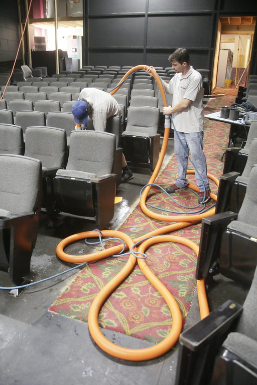 . Shaun Walker � The Times-Standard  Isaiah Hardwick, left, and Chris Littlejohn of A-1 Cleaning Service pressure steam clean the Ferndale Repertory Theatre\'s new seats from a movie theater on Tuesday. The theater is undergoing an array of renovations prior to their season opening on Sept. 29. The lobby is being expanded, the carpet is being replaced, the interior is being repainted, and cast and production photos and sponsor information will be displayed better. Renovations have been made possible, in part, by funding from The Kurt Feuerman Foundation, Rotary Club of Ferndale, The McLean Foundation, and private donors. The work, supervised by the theater�s Technical Director Carl McGahan, has been done by volunteers.