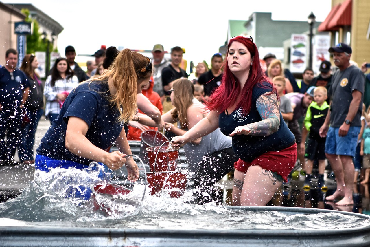 Explorers and Women firefighters of the Fortuna Fire Department compete in the timed bucket brigade contest. (José Quezada — For the Times-Standard)