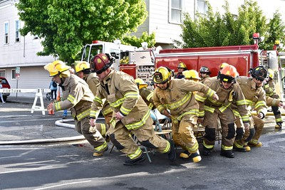 Fortuna Fire Department No. 3 take off for the start off the Hose Relay race. (José Quezada — For the Times-Standard)