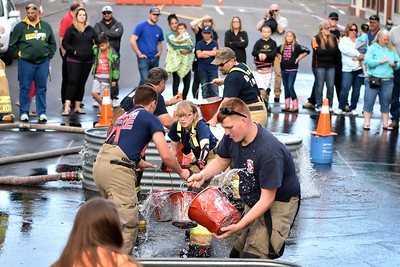 Bucket brigade splashing and dashing for the Fireman's Games. (José Quezada — For the Times-Standard)