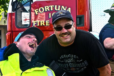 Patrick is an honorary Fortuna Firefighter, with his friend Jose at the start of the Fireman's Games. (José Quezada — For the Times-Standard)