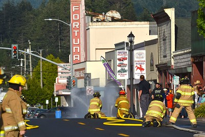 Ferndale Fire Department competes in the hose relay competition. (José Quezada — For the Times-Standard)