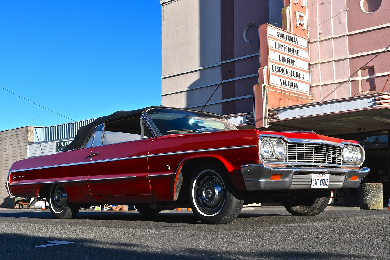 A Chevrolet Impala swings by the theater. José Quezada — For the Times-Standard
