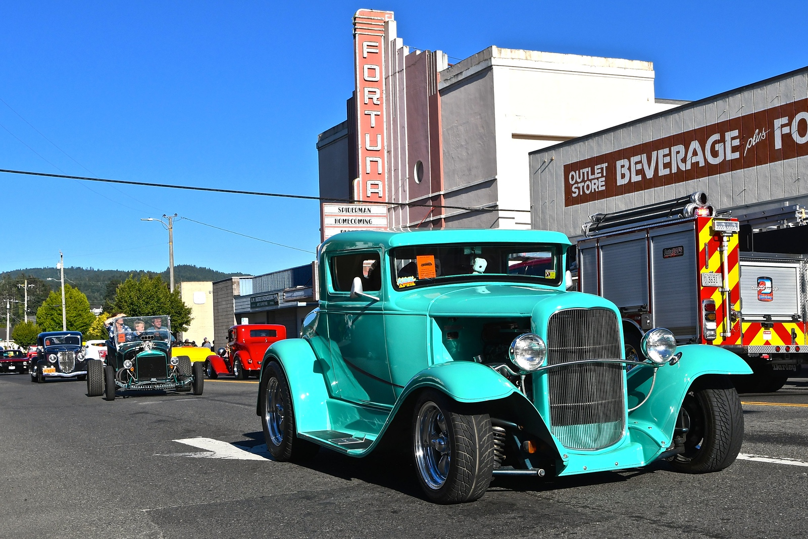 Electric aqua colored hot rod rumbles past the Fortuna theatre. José Quezada — For the Times-Standard