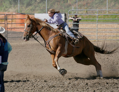 Shaun Walker — The Times-Standard  Sarah George of Oakdale rides hard during junior junior barrel racing at the 24th-annual Fortuna Junior Rodeo on Wednesday. Thursday features more junior rodeo and carnival action in Rohner Park during the day, fireman's games on Main Street at 6:30 p.m., and adult barrel racing at 7p.m.