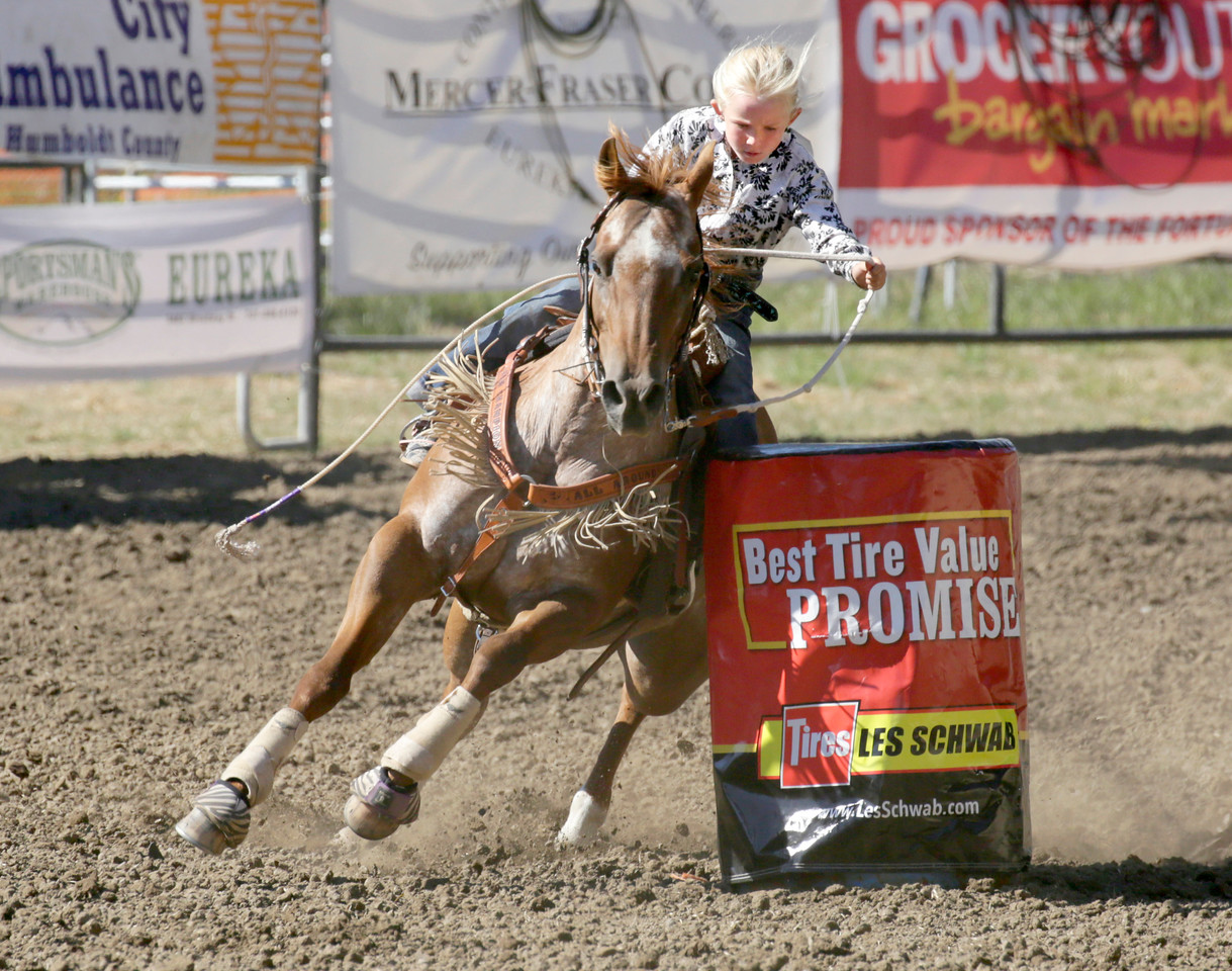 Shaun Walker — The Times-Standard  Jayci Ladner of Klamath Falls, Oreg., cuts it tight during junior junior barrel racing at the 24th-annual Fortuna Junior Rodeo on Wednesday. Thursday features more junior rodeo and carnival action in Rohner Park during the day, fireman's games on Main Street at 6:30 p.m., and adult barrel racing at 7p.m.