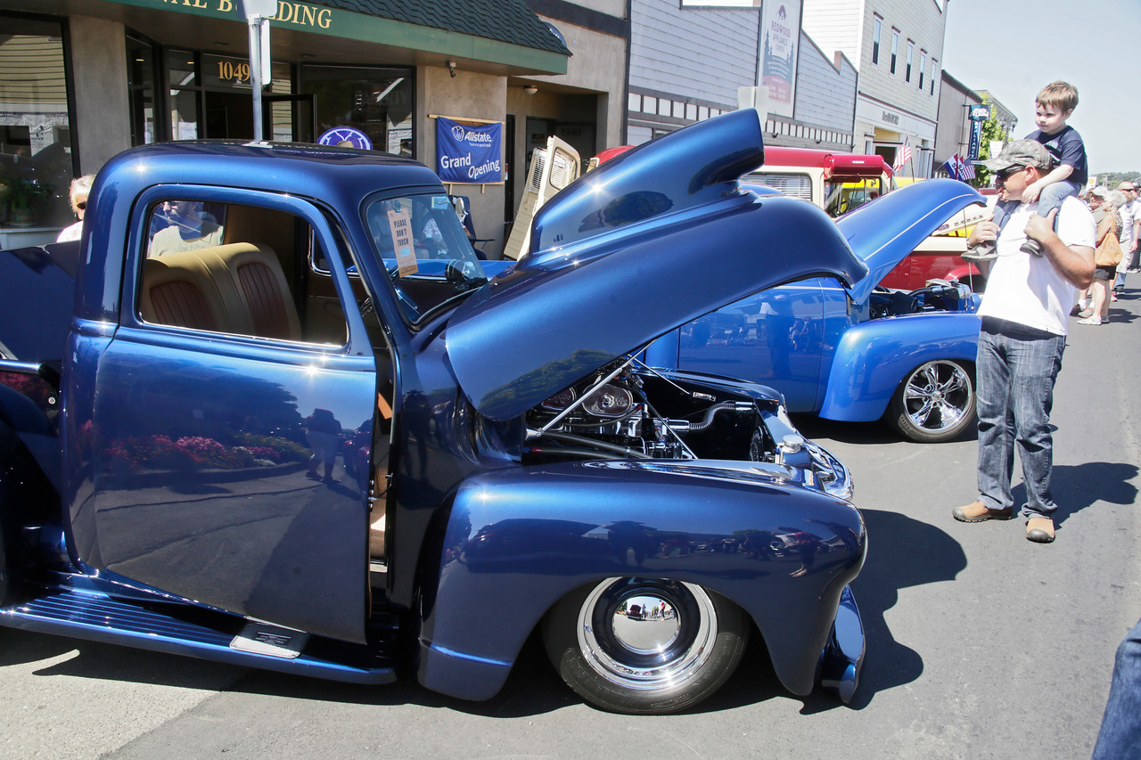 Shaun Walker — The Times-Standard  Will Kindley of Eureka and son Jarett, 3, admire the highly modified 1953 Chevrolet Pick Up of Chirs Morris of Gridley at the Fortuna Redwood AutoXpo on Main Street on Saturday. The event continues Sunday at Rohner Park with a swap meet, antique tractor pull, hit and miss engines, an and artisans fair.