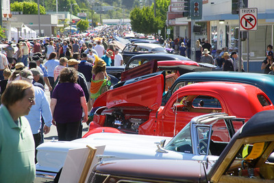 Shaun Walker — The Times-Standard  Vintage car admirers walk past cars at the Fortuna Redwood AutoXpo on Main Street on Saturday. The event continues Sunday at Rohner Park with a swap meet, antique tractor pull, hit and miss engines, an and artisans fair.