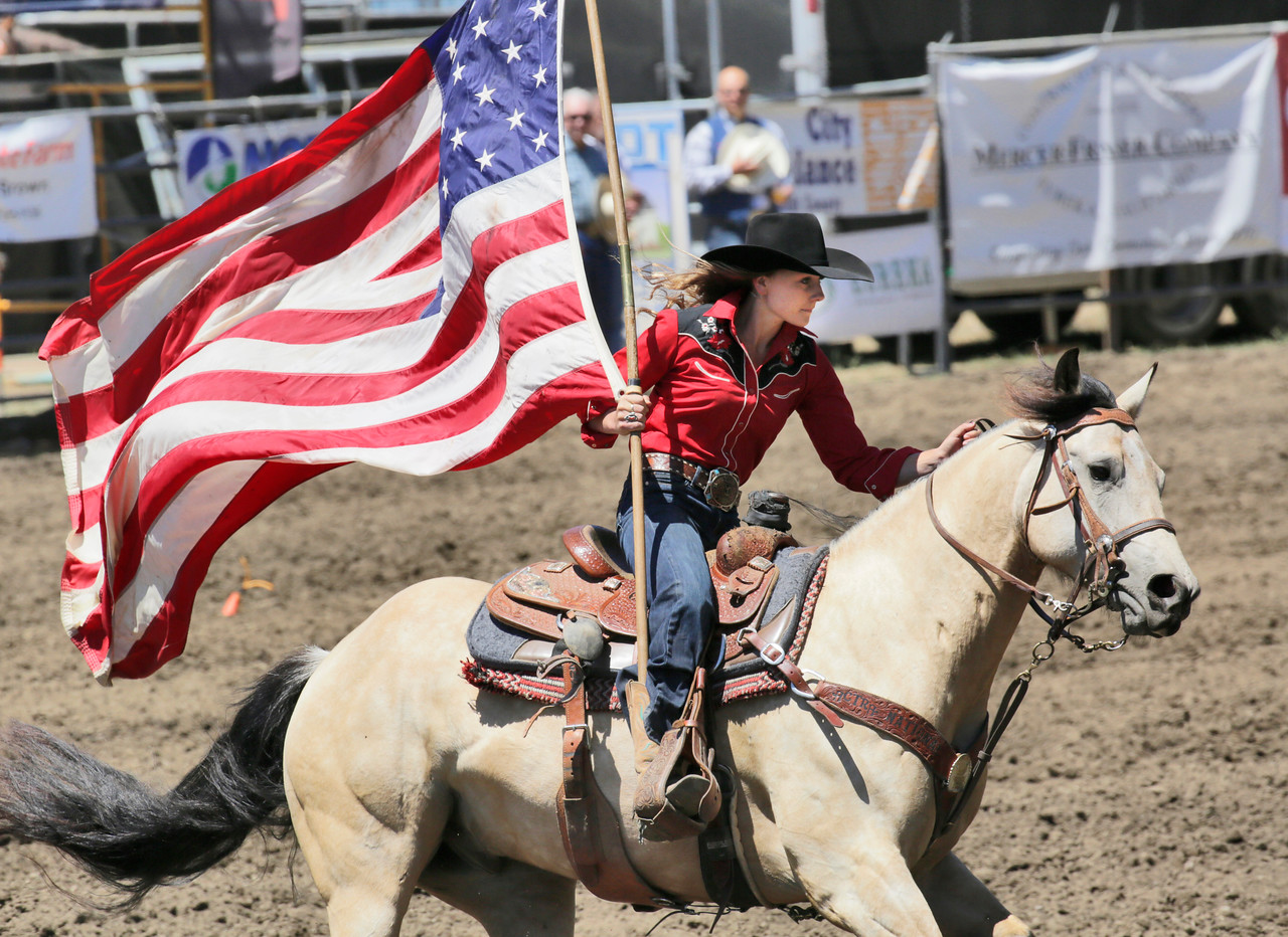 Shaun Walker — The Times-Standard  Kayla Moore rides through the Rohner Park Rodeo Arena with the American flag during opening ceremonies on Saturday. The Fortuna Rodeo concludes today with a run and walk at 9 a.m., barbecue with live music at 11 a.m., carnival at noon, and rodeo action at 1:30 p.m. For more information, go to fortunarodeo.com.