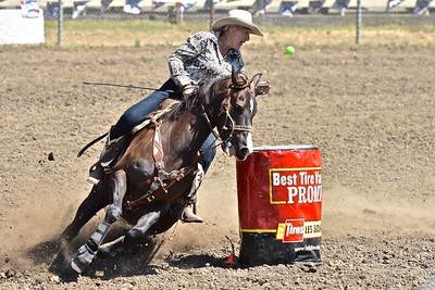 Cathey Vallerga of Lower Lake takes a tight turn in the Barrel Racing event. José Quezada—For the Times-Standard