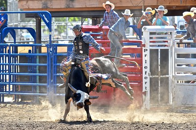 JR Liufau of Eureka keeps his composure shortly after starting his bull ride. José Quezada—For the Times-Standard