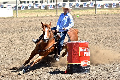 Susan Reite goes low in the dust for the barrel racing turn. José Quezada—For the Times-Standard