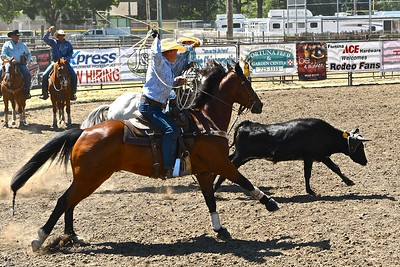 Adam and Dennis Fitze compete in the Team Roping competition. José Quezada—For the Times-Standard