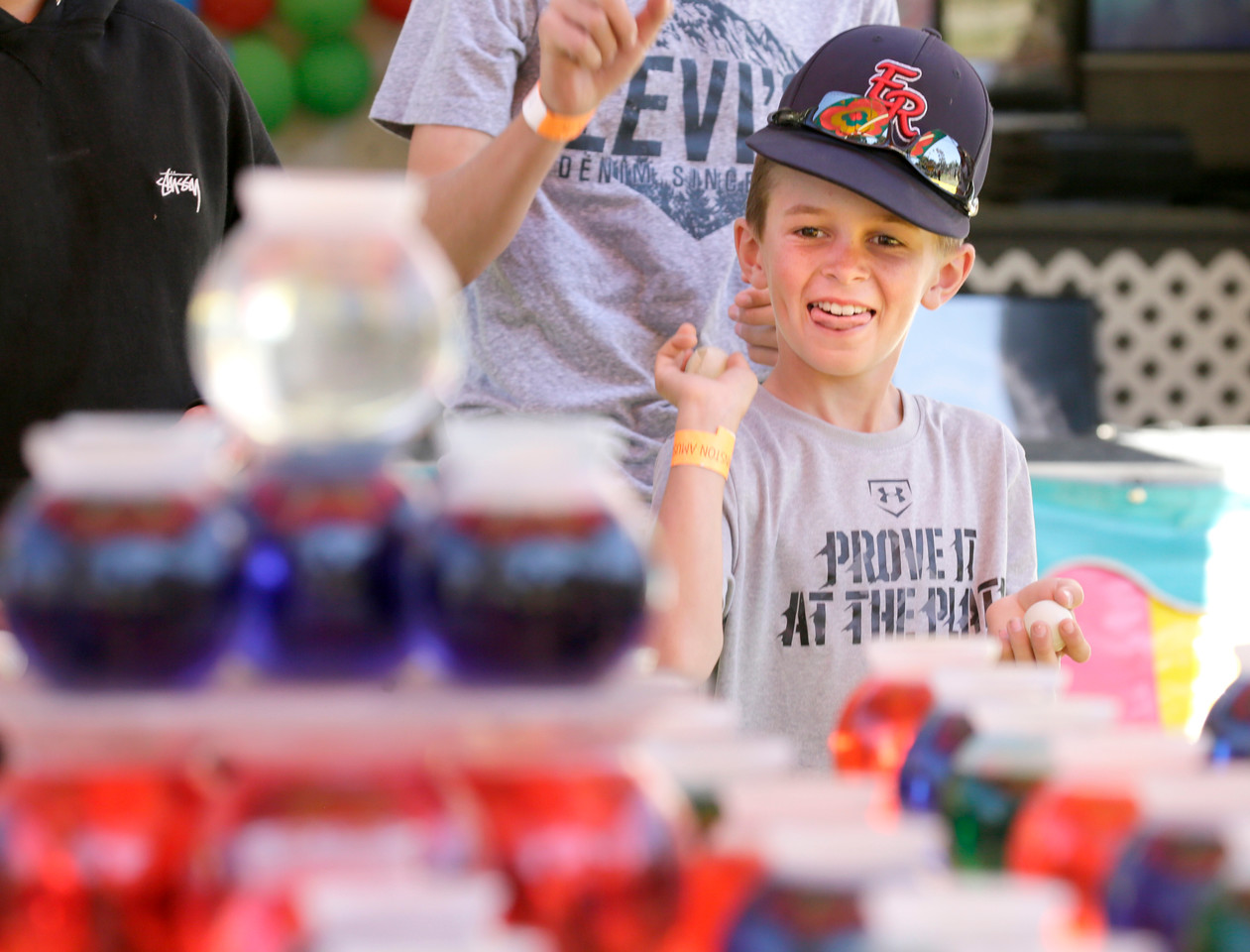 Shaun Walker — The Times-Standard  Parker Prior, 10, of Hydesville throws a ball at the Fortuna Rodeo carnival on Friday. The rodeo continues today with Fortuna Kiwanis pancake breakfast at 7 a.m., a parade down Main Street and more carnival at noon, rodeo action at 2 p.m., and gates open for Bulls, Broncs, Bands, and Brews at 6 p.m. at the Rohner Park Rodeo Grounds. For more information, go to fortunarodeo.com.