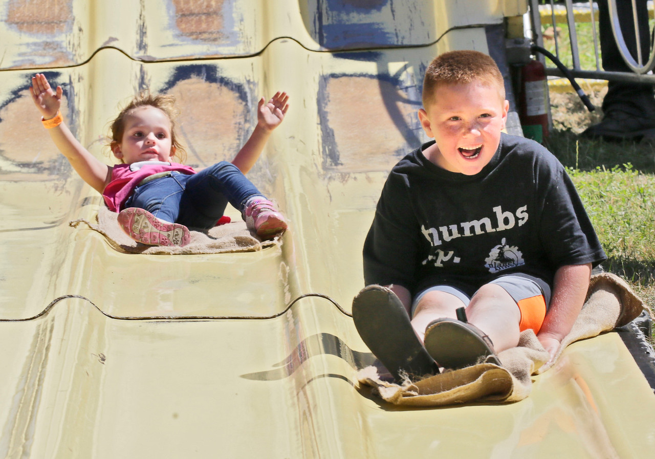 Shaun Walker — The Times-Standard  Aric Knapp, 7, right, of McKinleyville and Ellacyn Parvis, 2, of ride the Super Slide Hydesville at the Fortuna Rodeo carnival on Friday. The rodeo continues today with Fortuna Kiwanis pancake breakfast at 7 a.m., a parade down Main Street and more carnival at noon, rodeo action at 2 p.m., and gates open for Bulls, Broncs, Bands, and Brews at 6 p.m. at the Rohner Park Rodeo Grounds. For more information, go to fortunarodeo.com.