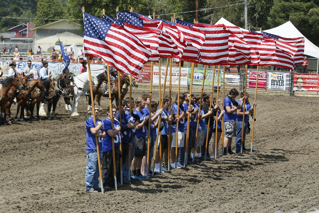 . Shaun Walker � The Times-Standard  Fortuna High School student athletes hold American flags at the start of the Fortuna Rodeo on Saturday afternoon. The rodeo continues today with a barbecue at 11 a.m., a carnival opening at noon, and rodeo action at 1:30 p.m., all in Rohner Park.