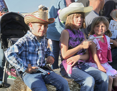 Shaun Walker — The Times-Standard  Zachary Reeves of Fortuna, 6, left, and sisters Desire, 8, and Emma, 3, hang out at the Fortuna Rodeo Week children's games and activities Tuesday evening. Wednesday features the opening of the carnival in Rohner Park at noon, junior rodeo action at 2 p.m., and Main Street games at 6 p.m. For more information, go to fortunarodeo.com.