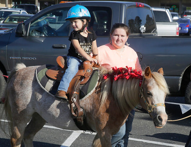Shaun Walker — The Times-Standard  Dayton Spaeth of Miranda, 3, gets a pony ride with the help of Taylor Flevares of Pretty Pony Parties at the Fortuna Rodeo Week children's games and activities Tuesday evening. Wednesday features the opening of the carnival in Rohner Park at noon, junior rodeo action at 2 p.m., and Main Street games at 6 p.m. For more information, go to fortunarodeo.com.