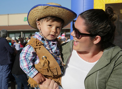 Shaun Walker — The Times-Standard  Little cowboy Manolo Gonzalez of Fortuna, 1, hangs out with mom Kelila at the Fortuna Rodeo Week children's games and activities Tuesday evening. Wednesday features the opening of the carnival in Rohner Park at noon, junior rodeo action at 2 p.m., and Main Street games at 6 p.m. For more information, go to fortunarodeo.com.