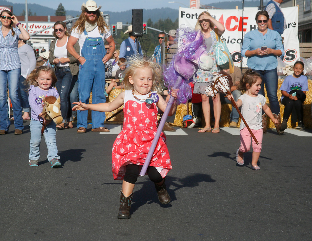 . Shaun Walker � The Times-Standard  Sierra Kennard, 3, of Fortuna, center, holds on as her purple unicorn gets a little wild during the stick horse races at Fortuna Rodeo Week Street Games on Main Street on Wednesday evening. Junior Rodeo action starts at 10 a.m. today in Rohner Park, and Fireman\'s Games start at 6:30 p.m. on main Street.
