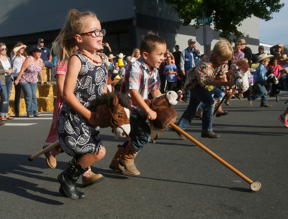 . Shaun Walker � The Times-Standard  Kennedy Herrera Baker, 5, of Rio Dell, left, and Carsyn Renner, 4, of Fortuna enjoy the stick horse races at Fortuna Rodeo Week Street Games on Main Street on Wednesday evening. Junior Rodeo action starts at 10 a.m. today in Rohner Park, and Fireman\'s Games start at 6:30 p.m. on main Street.