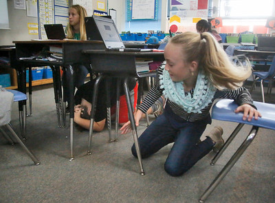 "Shaun Walker — The Times-Standard  Hannah Bass gets under her desk during the Great ShakeOut Earthquake Drills in Hollie Goodman's fourth grade class at Washington Elementary School in Eureka on Thursday morning. The worldwide event had over 55 million people registered to participate, of which nearly 40,000 were in Humboldt County, mostly students. Rescue teams, emergency managers, researchers, and school safety advocates, all agree that the drill's ""Duck, Cover, and Hold On"" is the appropriate action to reduce injury and death during earthquakes, according to the event website at earthquakecountry.org. ""Methods like standing in a doorway, running outside, and 'triangle of life' method are considered dangerous and are not recommended."""