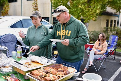 Chris Emmons and wife Tara Emmons, longtime supporters for all Humboldt State University athletic programs serve up another plate of fine tailgate cooking goodness, included but not limited to roast beef sliders, hash brown casserole, graze-grown hot chili, macaroni and green salads, plenty of beverages, cookies and chips and other hors d'oeuvres. Jose Quezada—For   José Quezada—For Times-Standard