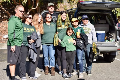 The Zechman, White and Thornburgh families giver a hoot and holler for their favorite Humboldt State Lumberjacks and their football squad shortly before game time at the end of the tailgate party. Jose Quezada—For Times-Standard