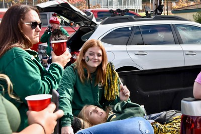 Humboldt State University softball coach Shelli Sarchett, left, enjoys her tailgate party-appropriate drink with Megan Holt and Chloe Teese, both pitching for the Women's HSU softball team. Jose Quezada—For Times-Standard