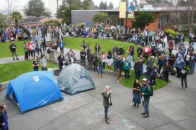 Shaun Walker — The Times-Standard  Students listen to speakers and pitch a couple tents on the Humboldt State University quad during a walkout to protest planned budget cuts Wednesday afternoon.