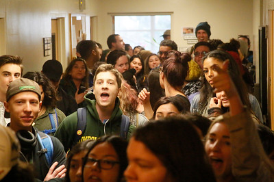 Shaun Walker — The Times-Standard  Students chant in the hallway outside the president's office at Humboldt State University  during a walkout to protest planned budget cuts Wednesday afternoon.