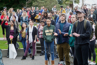 Shaun Walker — The Times-Standard  Students clap on the Humboldt State University quad during a walkout to protest planned budget cuts Wednesday afternoon.