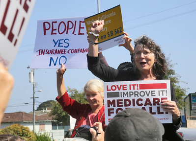 "Shaun Walker — The Times-Standard  Nurse Kathryn Donahue of the California Nurses Association and North Coast People's Alliance speaks a rally to voice support for the Healthy California Act, SB 562, in front of Assembly Member Jim Wood's offices in Eureka on Wednesday. The bill would create a single-payer ""Medicare for All"" health care system in California. The bill has already passed the State Senate, but attendees and rally organizers at the alliance want Wood to strongly support it and for it to make it out of the assembly. Activists in both Ukiah and Santa Rosa hosted parallel events yesterday at Woods district offices there."