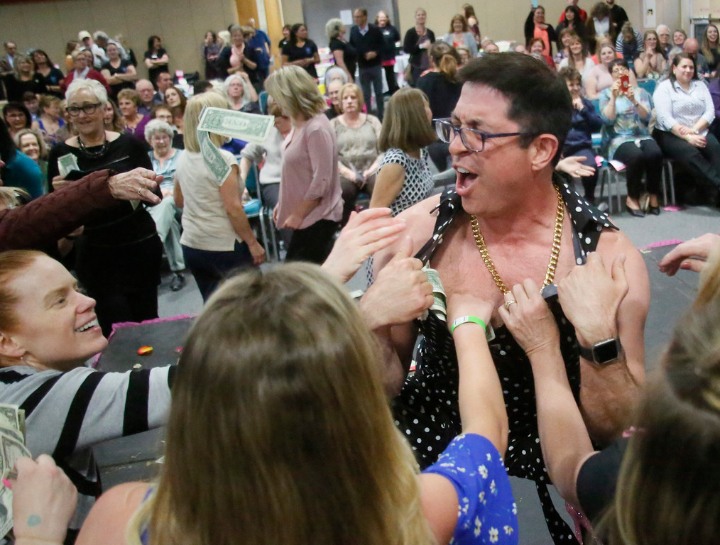 . Shaun Walker � The Times-Standard  Andy Parker of Azalea Realty shows some skin for a good cause at High Heels for Healing at the Eureka Adorni Center on Wednesday night. Over two dozen men in high heels strutted their stuff on the catwalk at the event, a major annual Soroptimist International of Humboldt Bay fundraiser. The lighthearted evening was partly meant to increases awareness of women\'s issues by featuring prominent local men in women\'s shoes. The funds raised will help support the club\'s donations to the local and global communities, such as grants and scholarships that help women move forward.