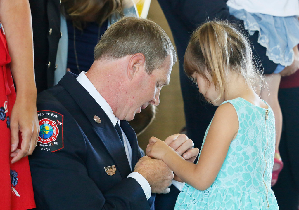 . Shaun Walker � The Times-Standard  Newly-promoted Humboldt Bay Fire Captain David Terry get his badge pinned on him by his daughter Anika, 4, during a ceremony at fire headquarters in Eureka on Friday. The event also included the following promotions: new Chief Sean Robertson, new Firefighter Nicholas Lyvers, Tim Citro promoted to battalion chief, Kris Kalman promoted to captain, Adam Bumgardner promoted to engineer, Michael Tyson promoted to engineer, and also John Owens completion of the volunteer academy.